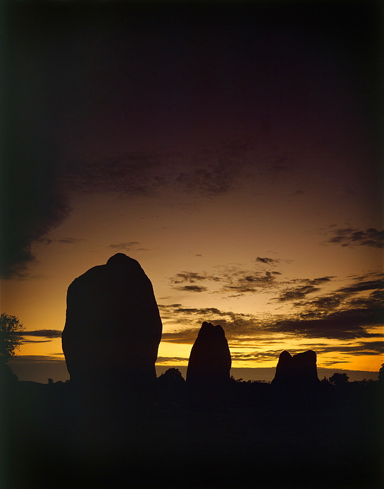 Sunrise with three stones, Avebury, UNESCO World Heritage Site, Wiltshire, England, United Kingdom, Europe