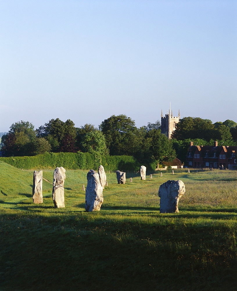 Part of the stone circle with village church in background, Avebury, UNESCO World Heritage Site, Wiltshire, England, United Kingdom, Europe