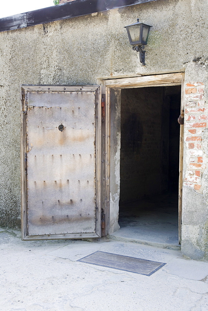 The wooden entrance door into the Gas Chambers at Auschwitz Concentration Camp, Poland, Europe