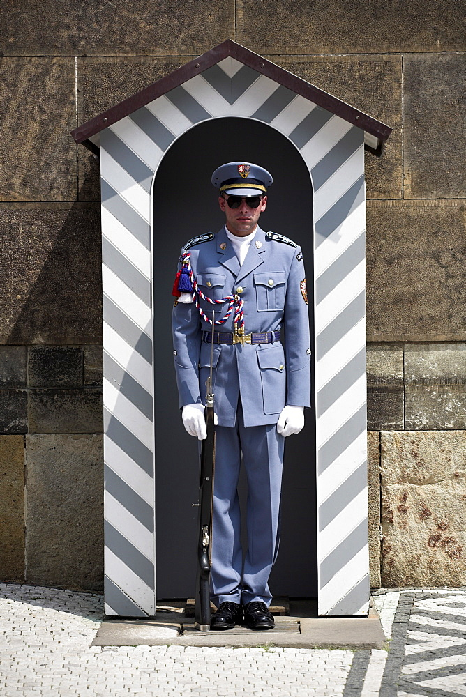 A guard stands in a sentry box at Prague Castle, Prague, Czech Republic, Europe