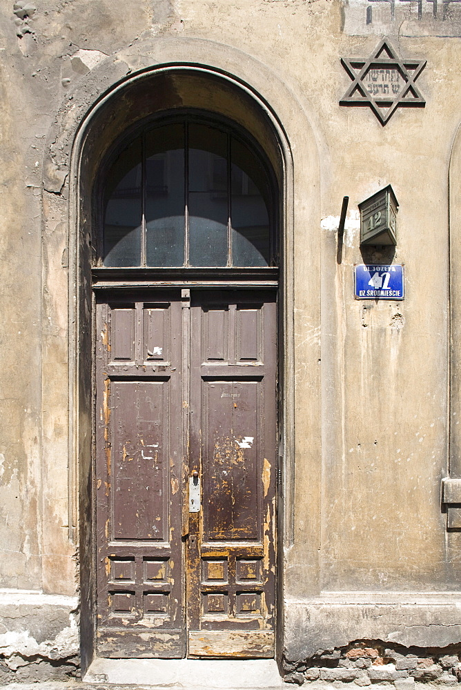 An old Jewish house with the Star of David on the wall, in Kazimierz, Krakow, Poland, Europe