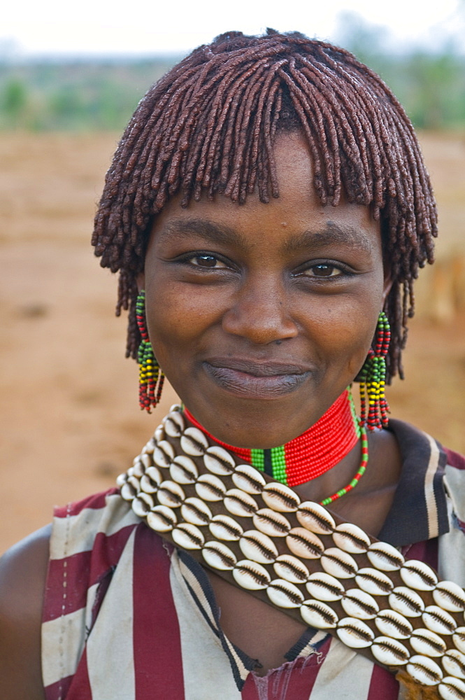 Friendly young Hamer woman, Jumping of the Bull ceremony, Omo Valley, Ethiopia, Africa