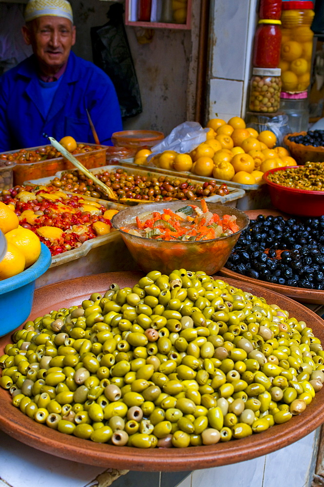Old man selling vegetables and olives in the bazaar of Safi, Morocco, North Africa, Africa
