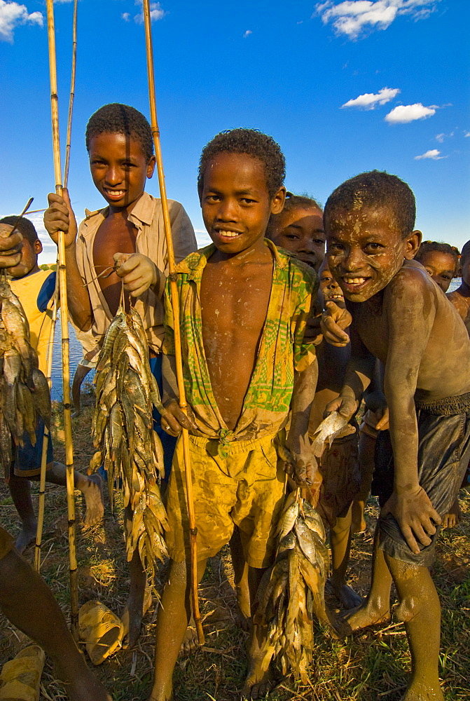 Young curious and dirty kids coming from fishing, Madagascar, Africa