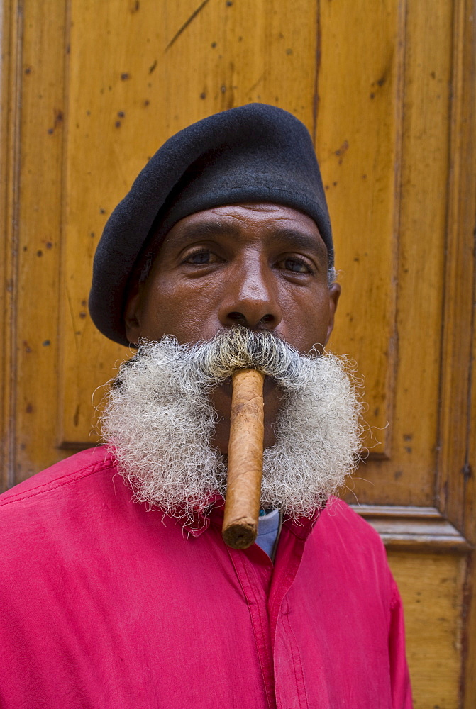 Revolutionary man smoking a cigar, Havana, Cuba, West Indies, Caribbean, Central America