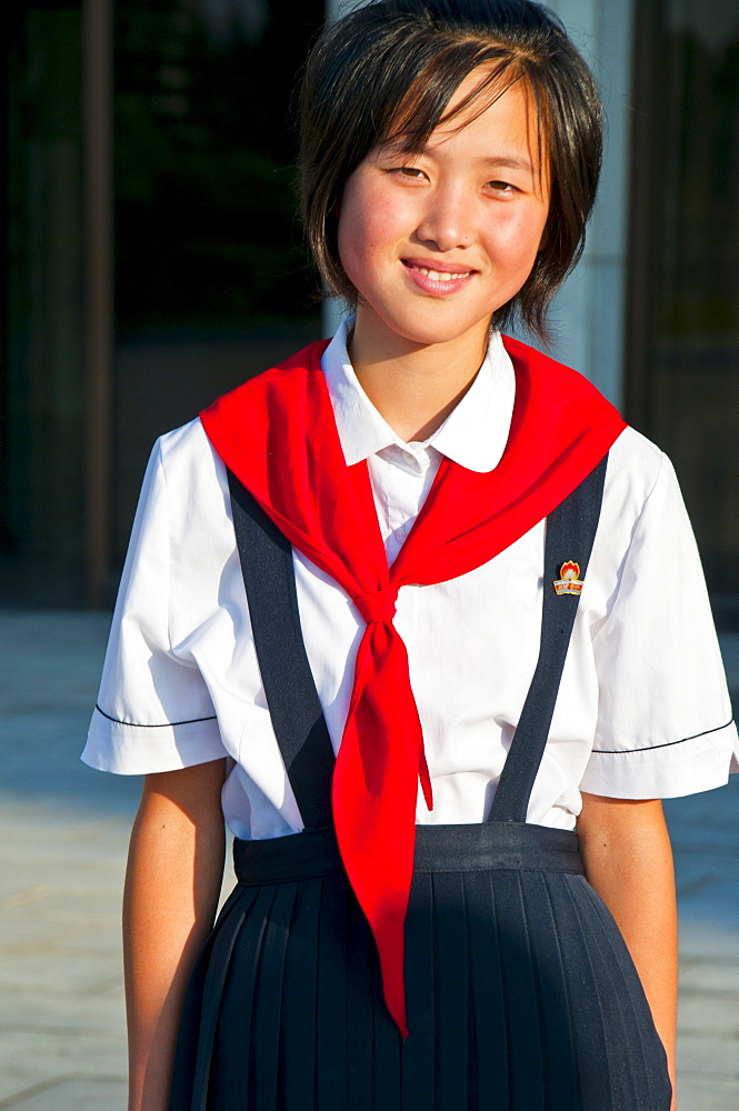 Young communist party girl at the Schoolchildrens palace, Pyongyang, North Korea, Asia