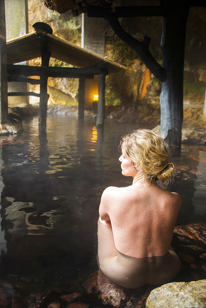 Woman enjoying the hot waters of the Kurokawa onsen, public spa, Kyushu, Japan, Asia