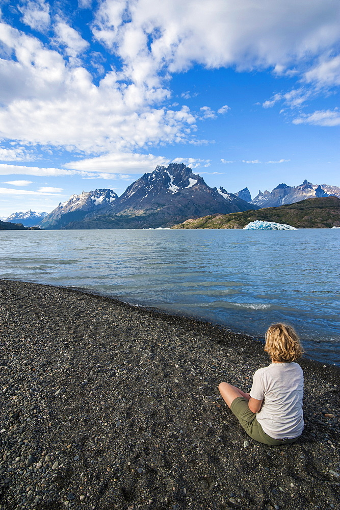 Woman enjoying Lago Grey lake in the Torres del Paine National Park, Patagonia, Chile, South America