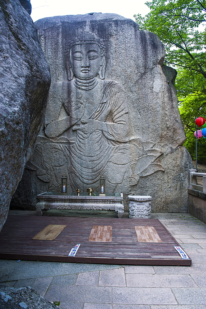Buddha carved in a rock cliff, Beopjusa Temple Complex, South Korea, Asia