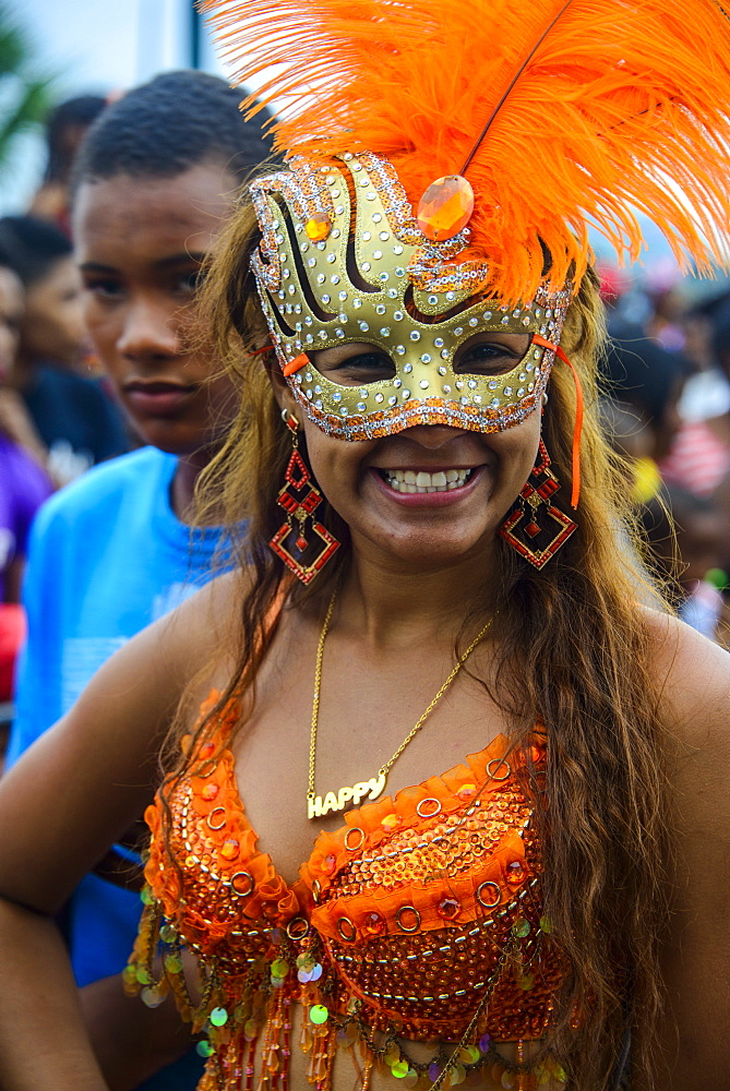 Colourfully dressed woman on the Carneval in Santo Domingo, Dominican Republic, West Indies, Caribbean, Central America
