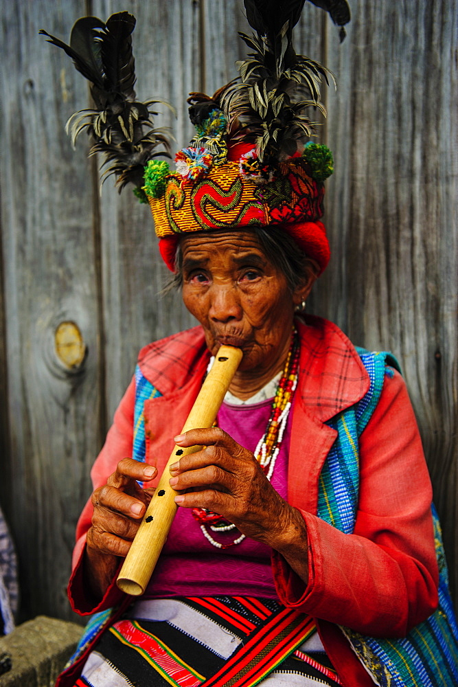 Traditional dressed Ifugao women playing the flute in Banaue, UNESCO World Heritage Site, Northern Luzon, Philippines, Southeast Asia, Asia