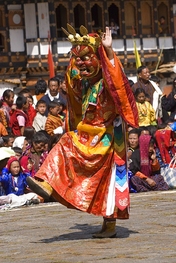 Masked dancer at religious festival with many visitors, Paro Tsechu, Paro, Bhutan, Asia