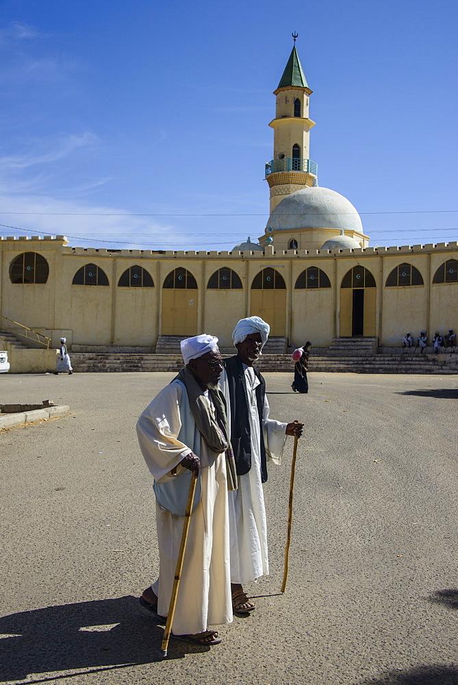 Old men walking in front of the Grand Mosque of Keren, Eritrea, Africa
