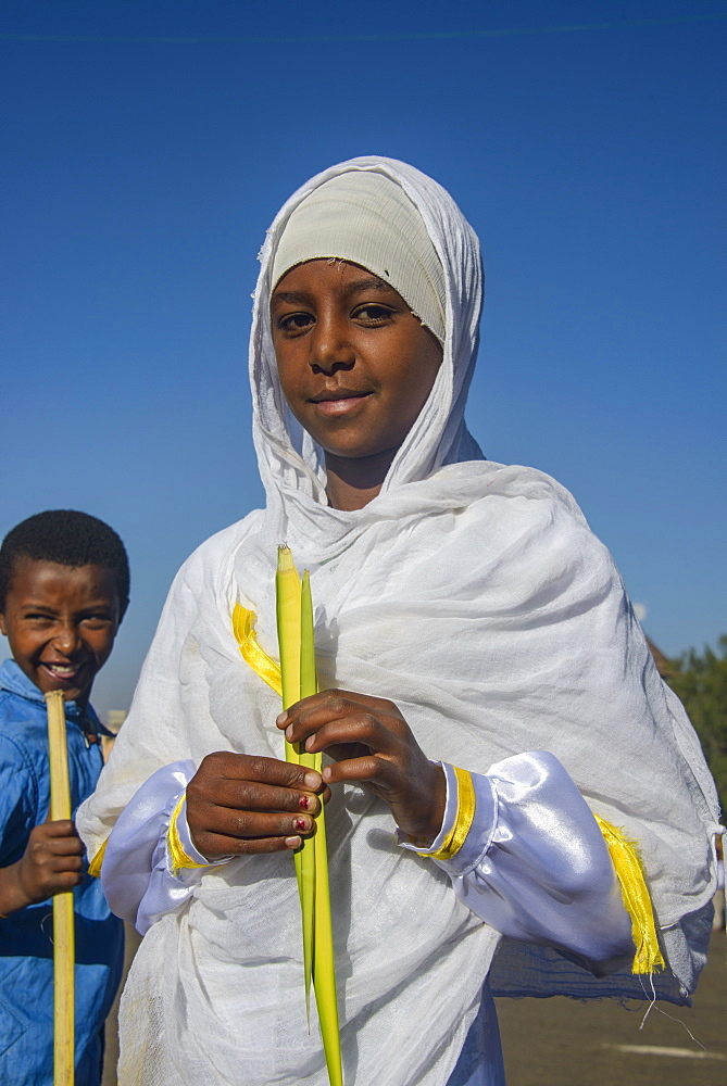 Orthodox girl praying at the Easter ceremony, Coptic Cathedral St. Mariam, Asmara, capital of Eritrea, Africa