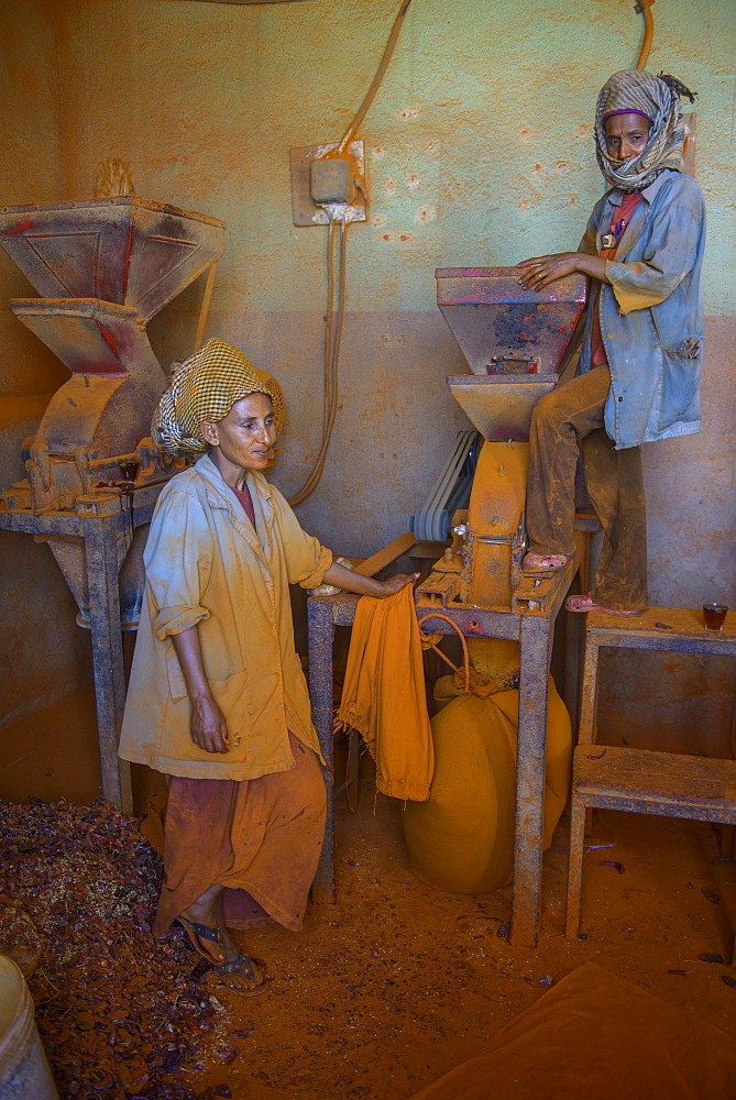 Women working in a Berbere red pepper spice factory at the Medebar market, Asmara, capital of Eritrea, Africa