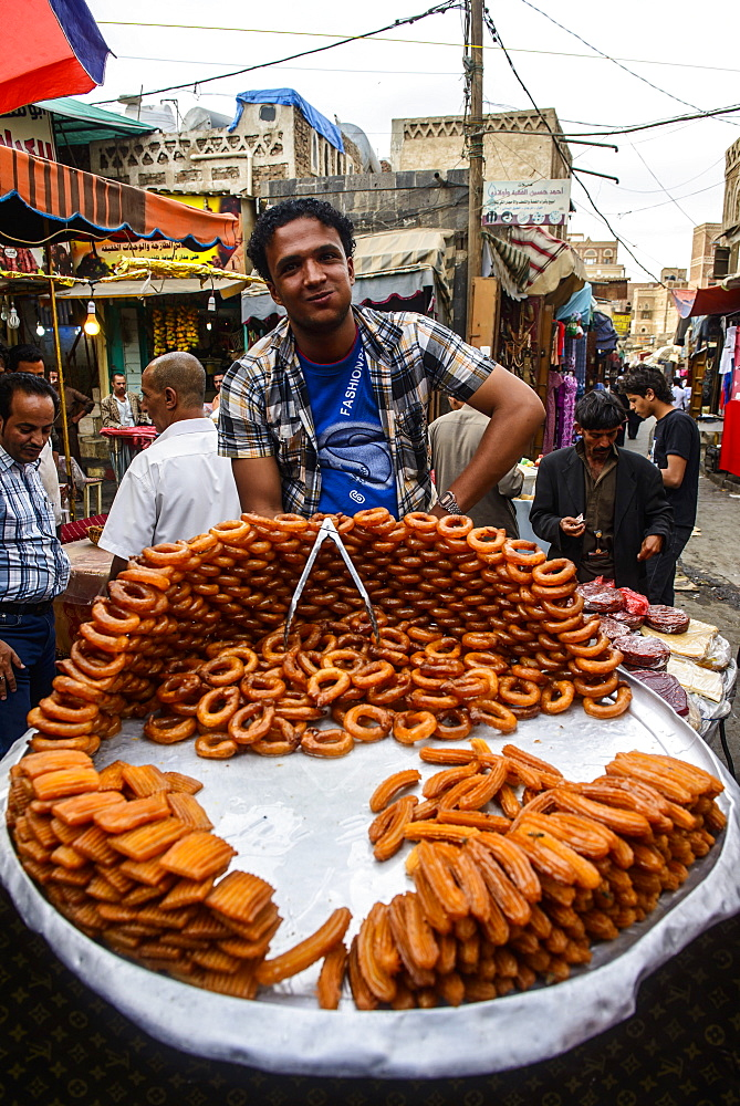 Man selling sweets in the Old Town, UNESCO World Heritage Site, Sanaa, Yemen, Middle East