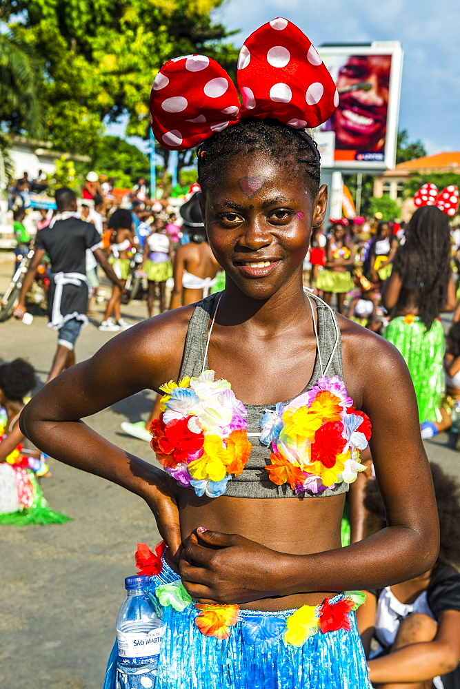 Girl posing at the Carneval in the town of Sao Tome, Sao Tome and Principe, Atlantic Ocean, Africa