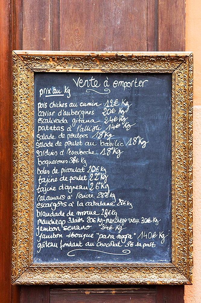 Restaurant menu written on a blackboard in Perpignan, France