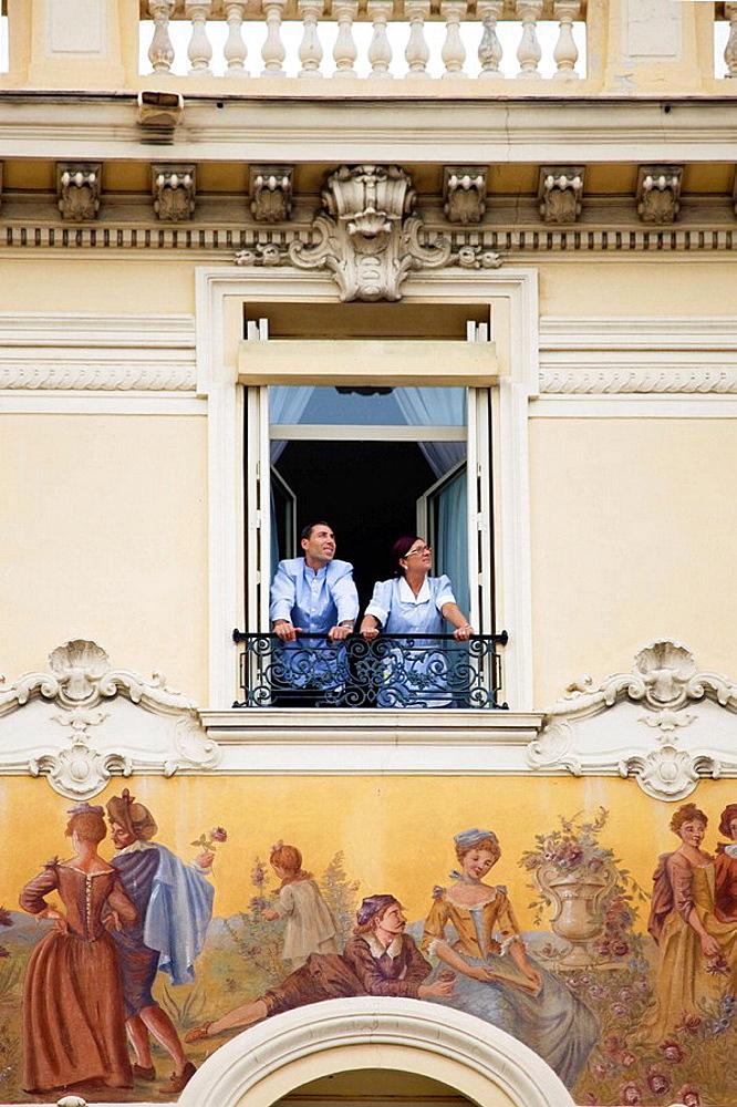 Staff in a window of a Monaco hotel - 817-103550