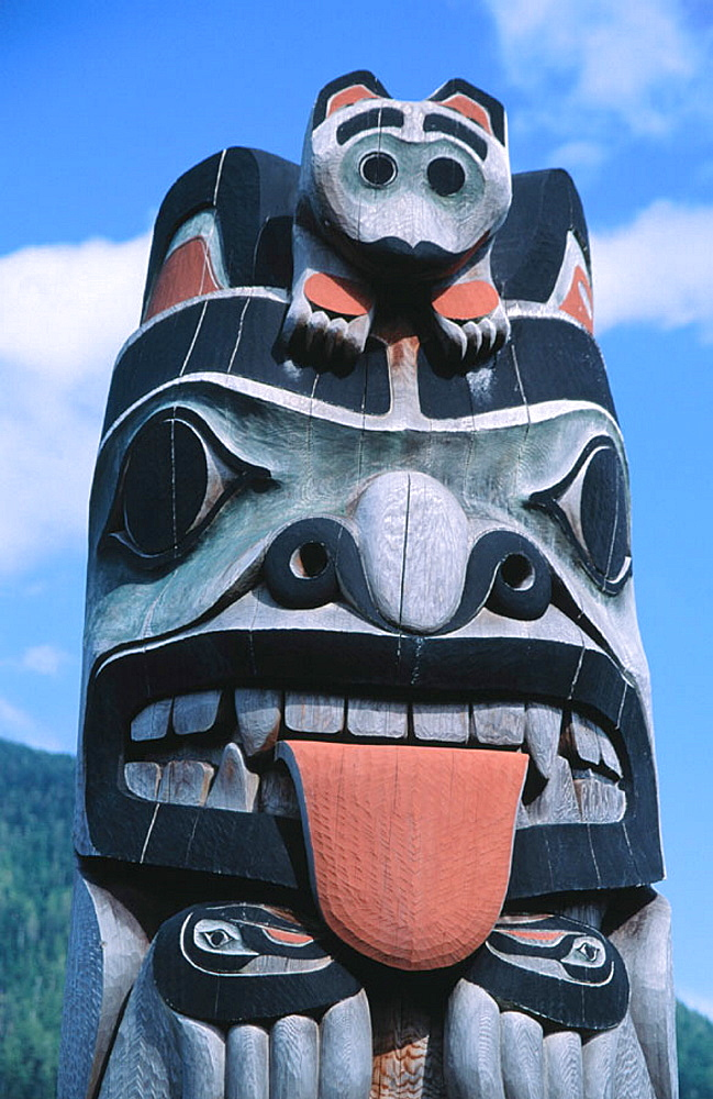 Tlingit native totem at Council of Clans totem circle, Ketchikan, Alaska, USA
