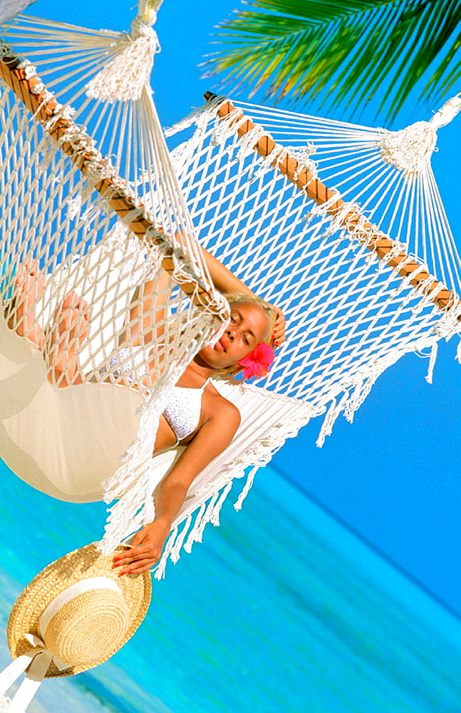 Woman on tropical beach, Maldives Islands