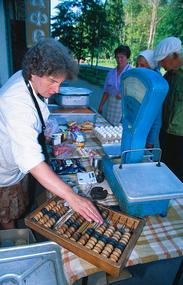Seller using abacus, Uglich, Russia