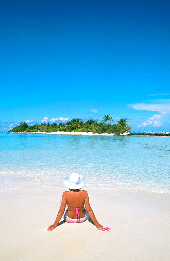 Woman on the beach in White Sands Resort and Spa, Ari Atoll, Maldives