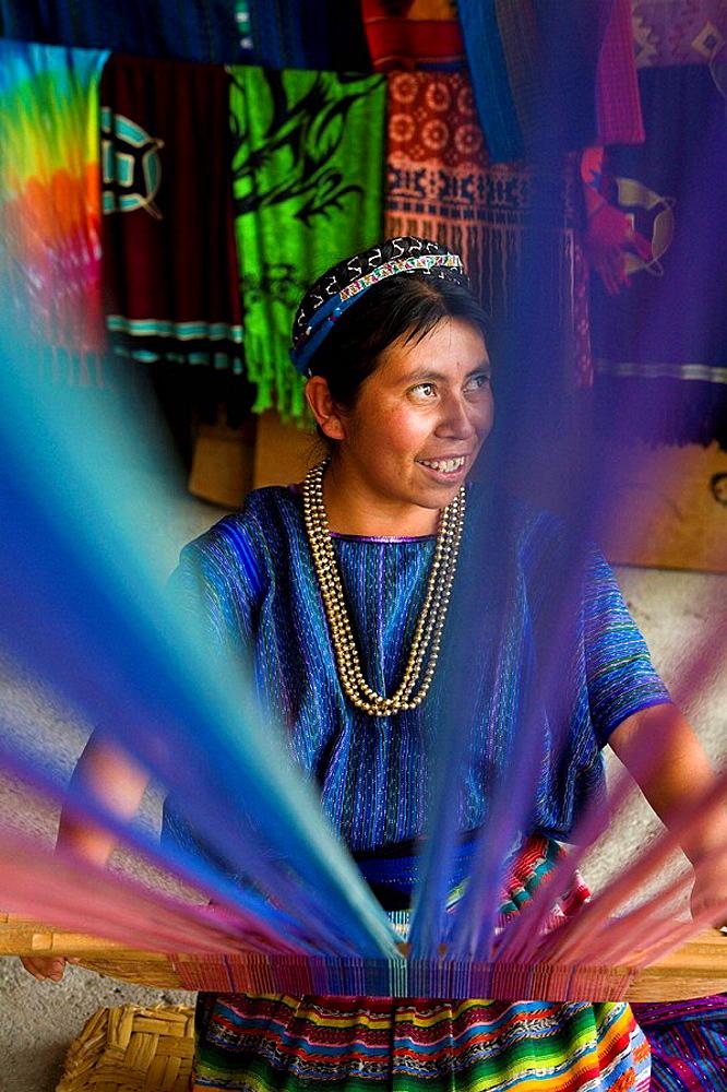 Woman using loom, San Antonio Palopo, Solola department, Guatemala