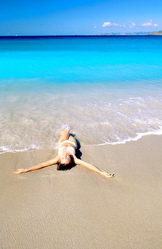 Caribbean, Saint Barthelemy, woman on beach at colombier bay