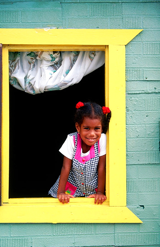 Caribbean girl at window, Willemstad, Curacao, Netherlands Antilles