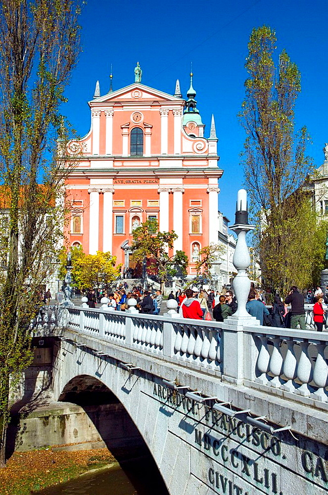 The Triple Bridge leading to Presernov Square and the Church of the Annunciation in Ljubljana, Slovenia, Europe
