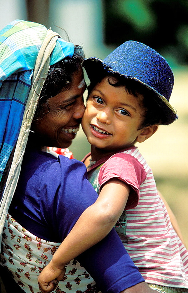Woman carrying her child, Sri Lanka