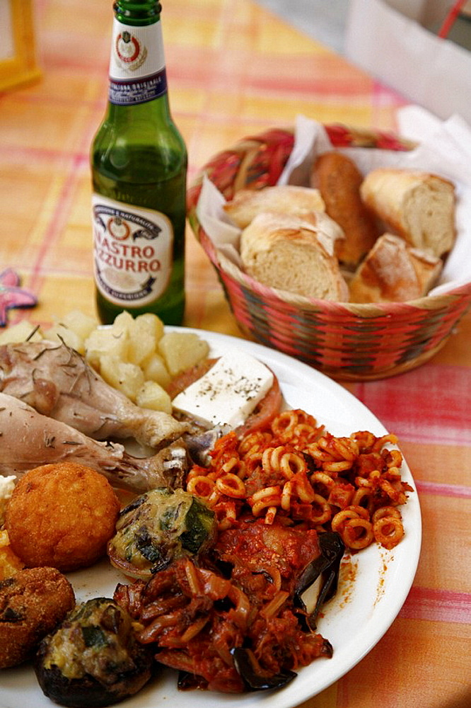 Local sicilian dishes on a plate, Palermo, Sicily