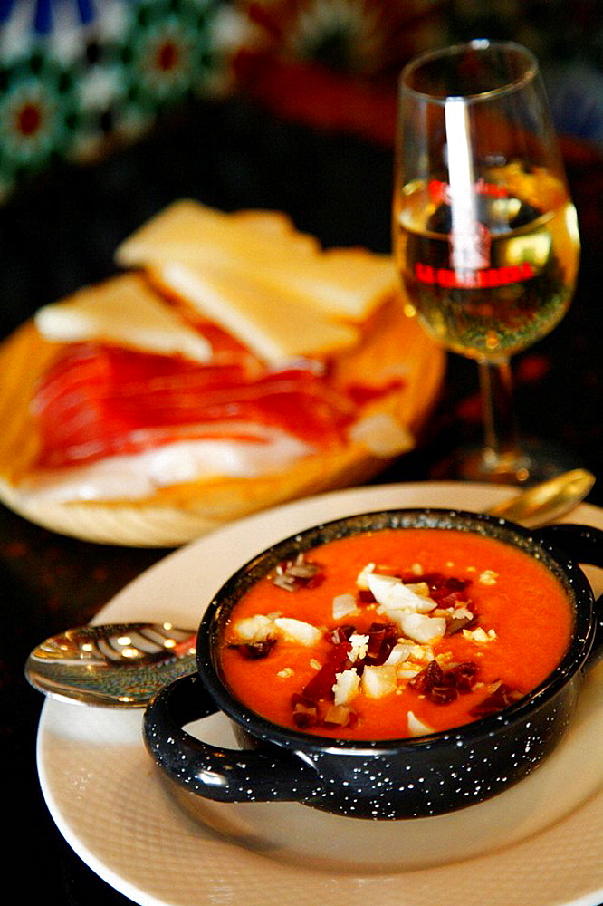 Tapas, Salmorejo soup and a plate of ham and cheese, Seville, Spain
