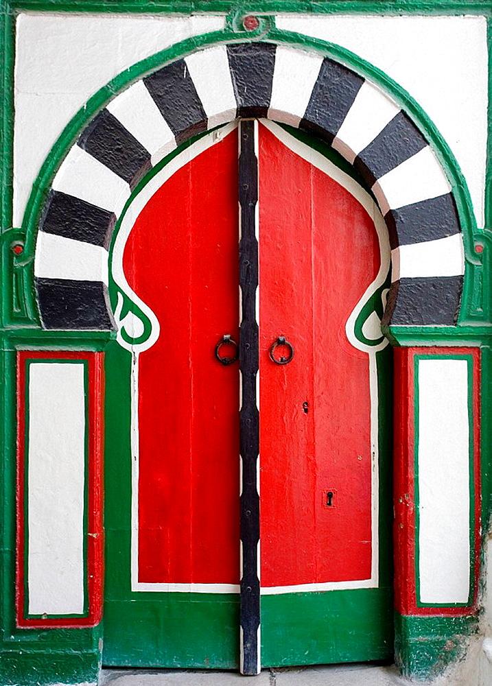 Colourful entrance door to a Hammam in the Medina, Tunis, Tunisia