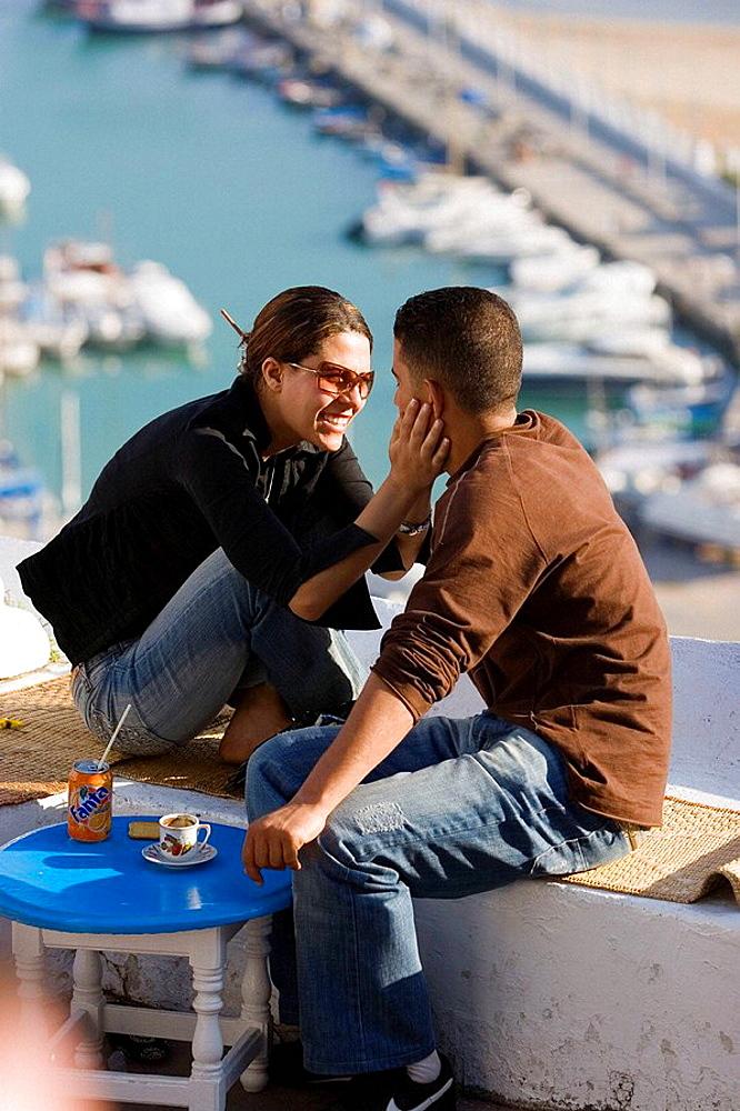 young couple sitting at Cafe Chebaane, Sidi Bou Said, Tunisia