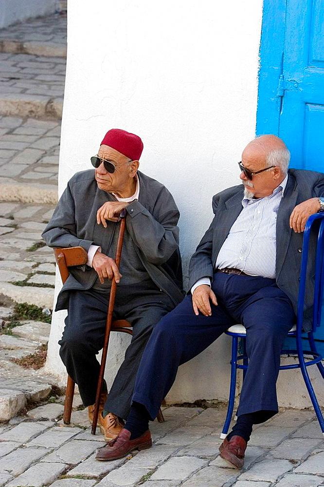 Men sitting outside, Sidi Bou Said, Tunisia