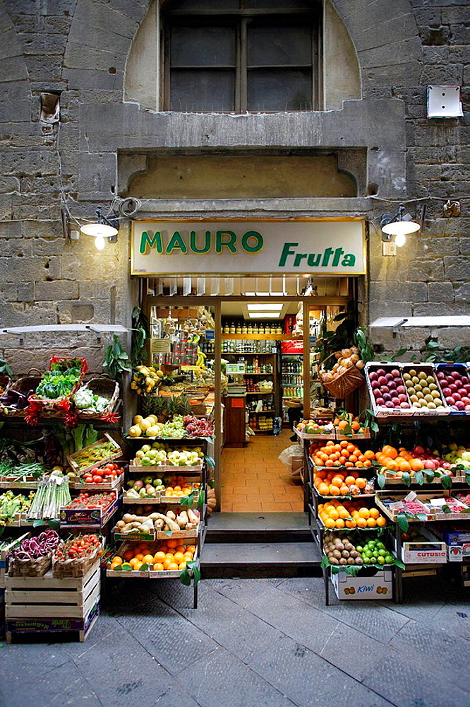 Traditional grocery store selling fruit and vegetable seen from front in a side street of the heart of Florence (Firenze), Tuscany, Italy, Southern Europe