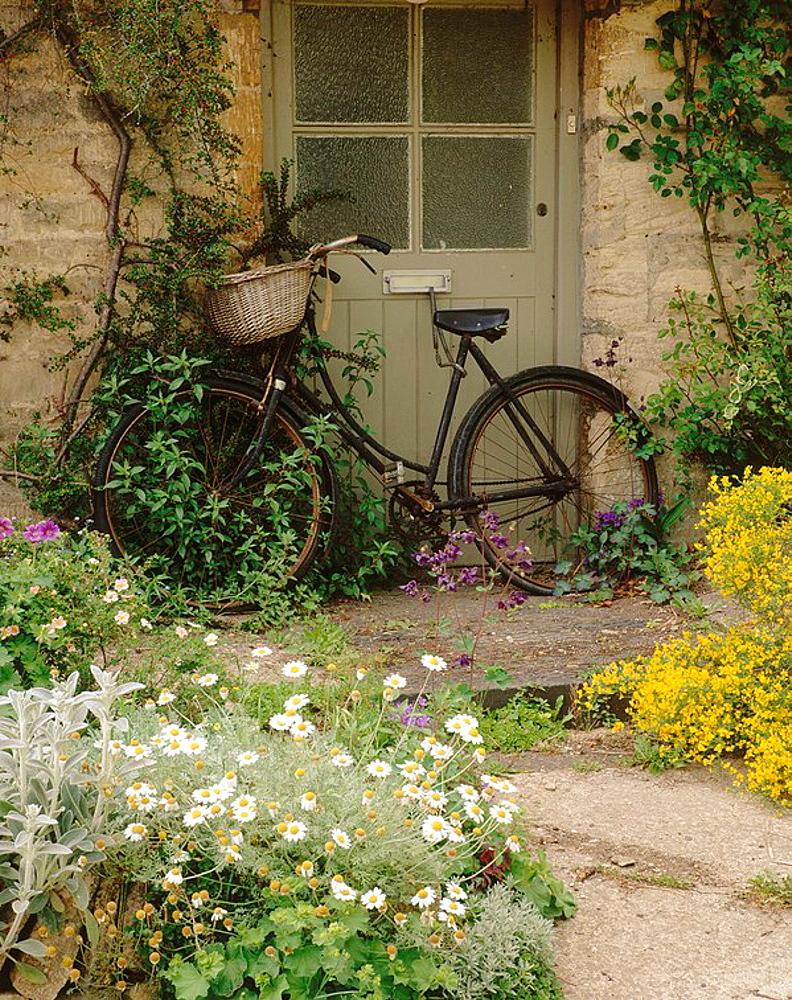 Bicycle in Bibury doorway, Gloucestershire, England.