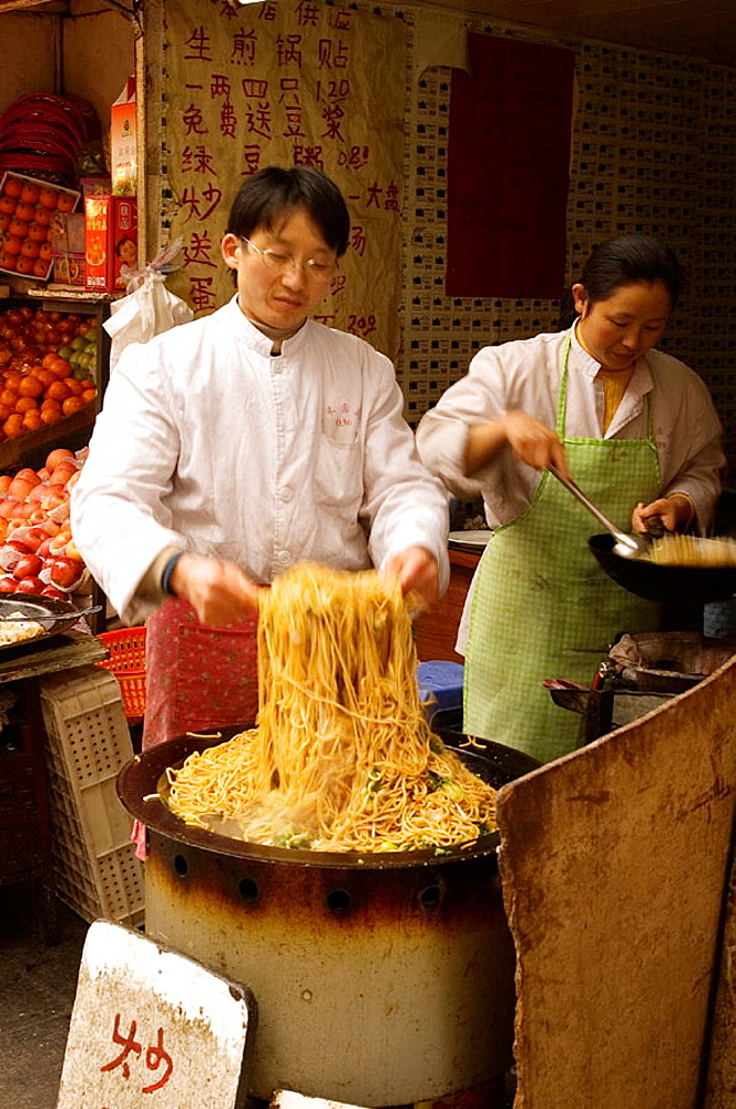 Street vendor cooking fried noodles, Shanghai, China