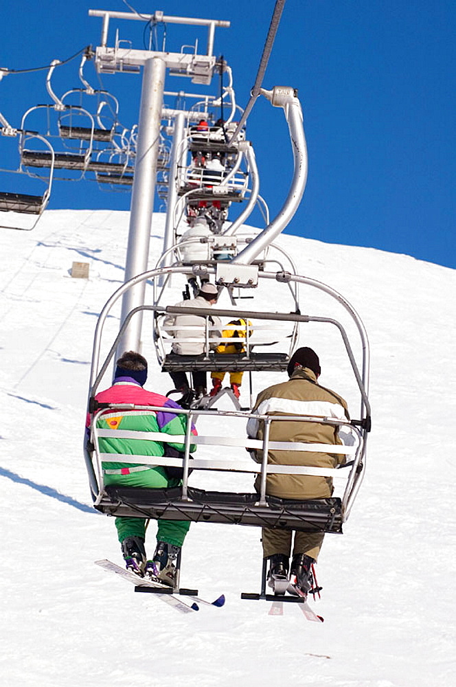 Skiers on a ski lift, Tignes, The Alps, France