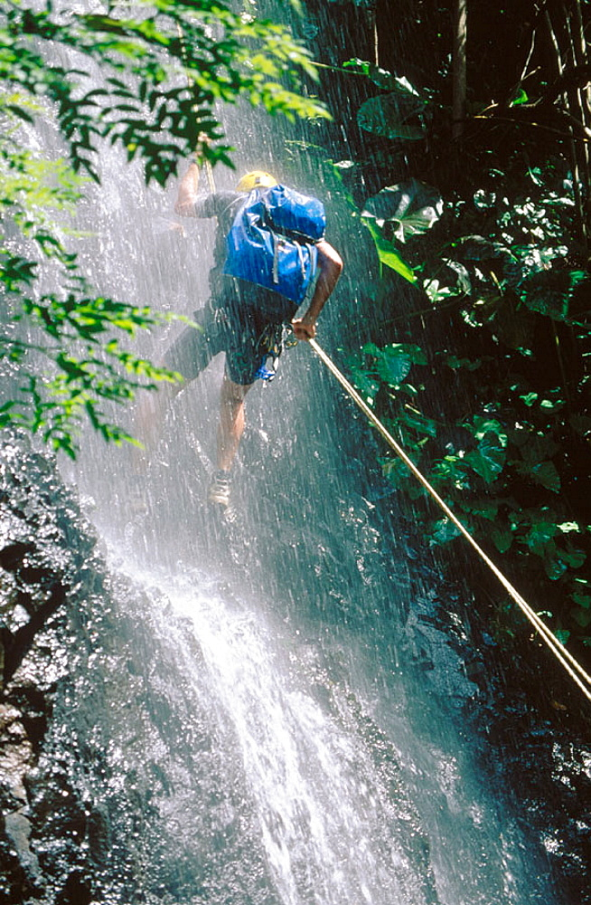 Canyoning in a waterfall.