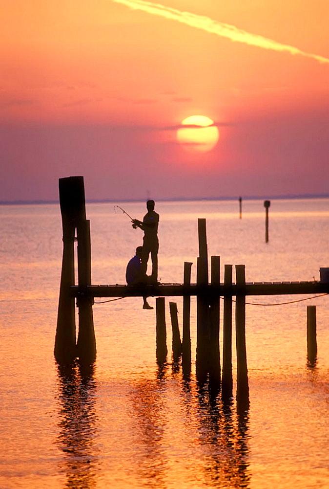 Fishing at sunset off of a pier at Sarasota Florida, USA - 817-147188