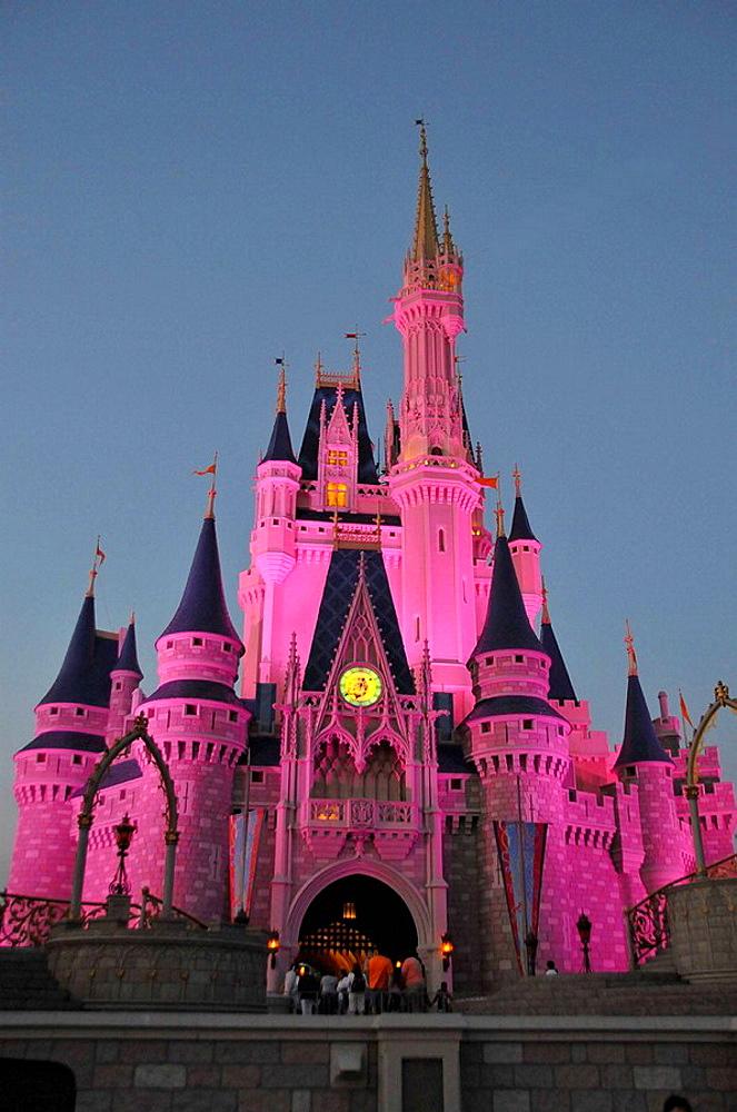 Evening illuminated view of Cinderella Castle at Walt Disney Magic Kingdom Theme Park Orlando Florida Central - 817-147882