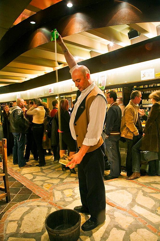 Pouring cider in TierrAstur cider house, 'cider boulevard' area, Oviedo, Asturias, Spain
