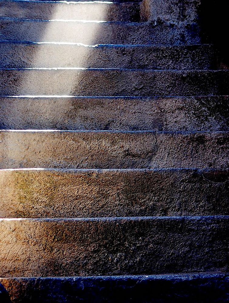 Old stone stairs in Vernazza, in the Liguria region, with a spot lateral light - 817-175391