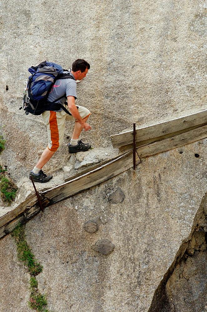 Hiker, Cavallers, Vall de Bohi, Pyrenees, Lleida province, Spain