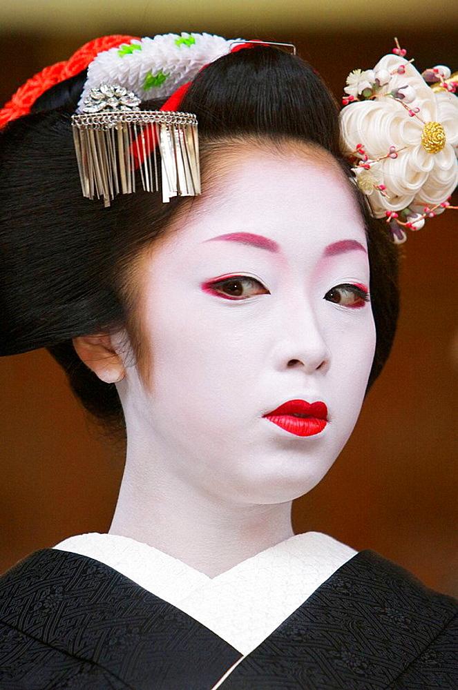 A geisha at the Setsubun, beginning of spring festival at Yasaka Shrine in Kyotos Gion district