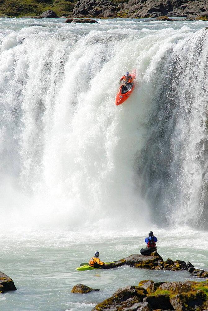 Kayaking at Godafoss waterfall, Iceland - 817-183573