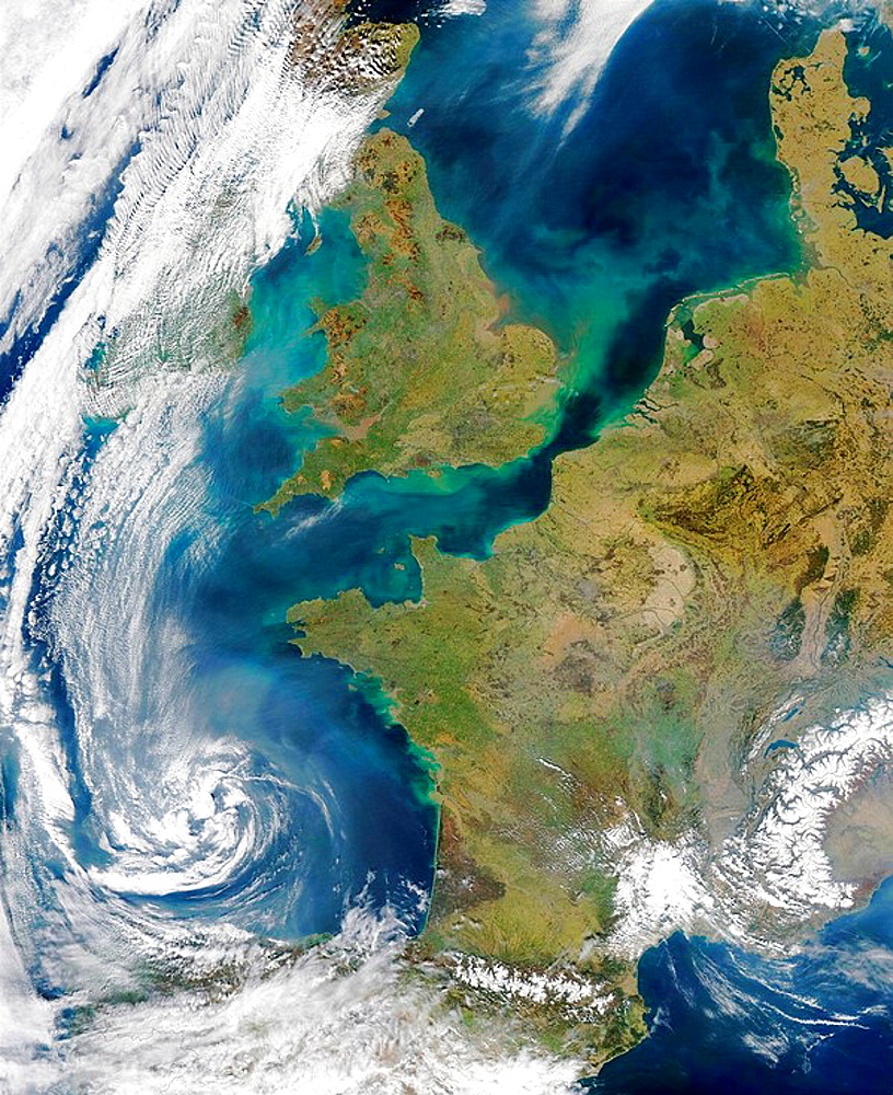 Pollution and smoke get caught up in a swirl of clouds off on the coasts of Spain bottom center), France (center), the United Kingdom (top center), and Ireland (under cloud at top left) in this true-color Aqua MODIS image acquired on March 22, 2003 - 817-183675